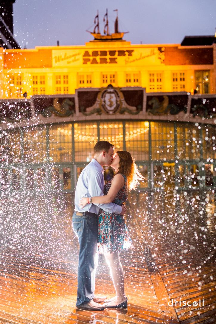 Kissing in the Rain! Asbury Park Engagement Photo by Kristen Driscoll Photography. Location Convention Hall